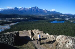 Hikers reach the summit of Old Fort Point overlooking Jasper after a short climb from the Athabasca River trailhead.