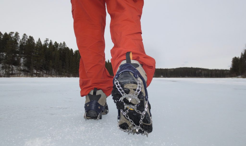 Hiking across a frozen lake in a pair of Hillsound Trail Crampon Ultras.