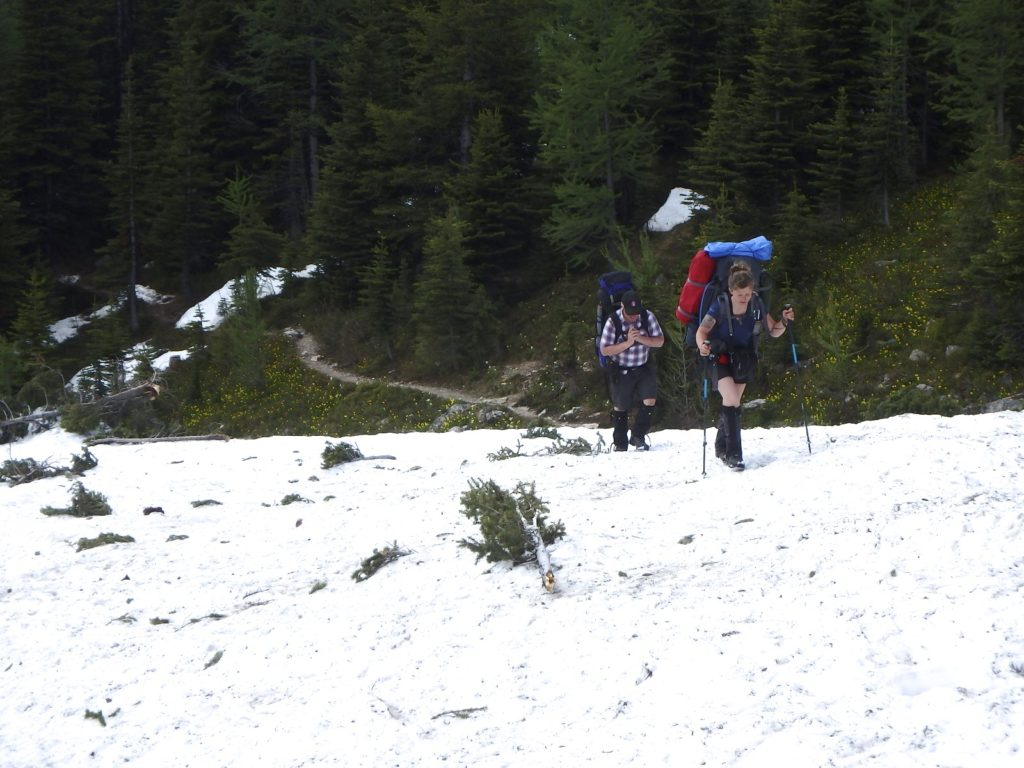 Backpackers crossing a major snow slide on the climb from Banff's Marvel Lake to Wonder Pass on June 30th. Jim Shipley photo.