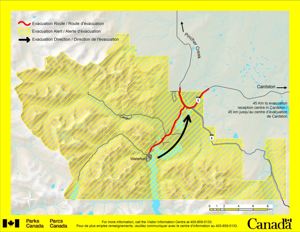 Parks Canada map indicates the closure area and evacuation routes from Waterton townsite to the north and east.